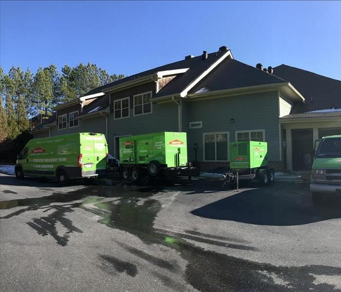 SERVPRO trucks in front of a residential job