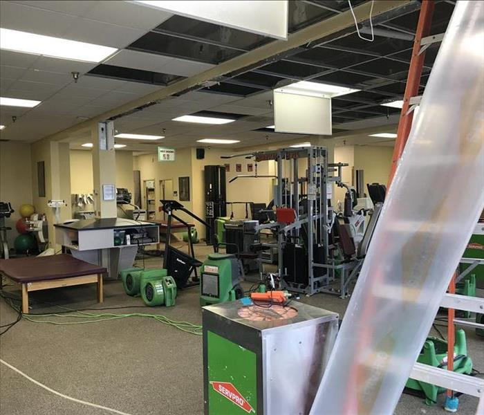 SERVPRO dealing with water damage at a gym