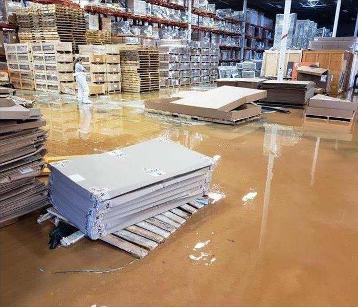 Flooded warehouse, black water damage